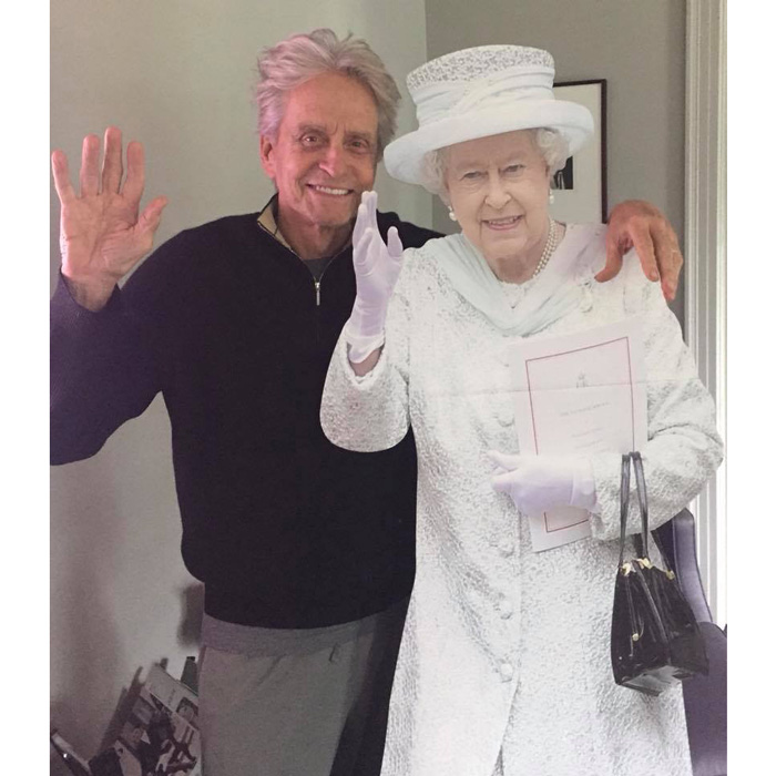 Michael posted a funny photo of himself and a cut out of Queen Elizabeth Photo Facebook Michael Douglas