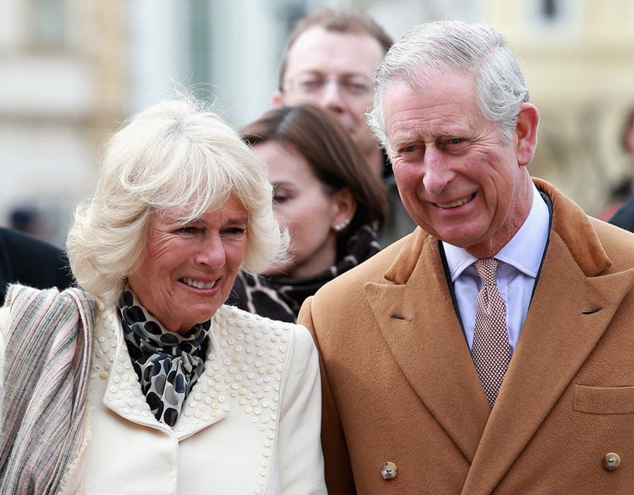 Prince Charles, Prince of Wales and Camilla, Duchess of Cornwall laugh as they watch traditional Croation Dancers Photo (C) GETTY