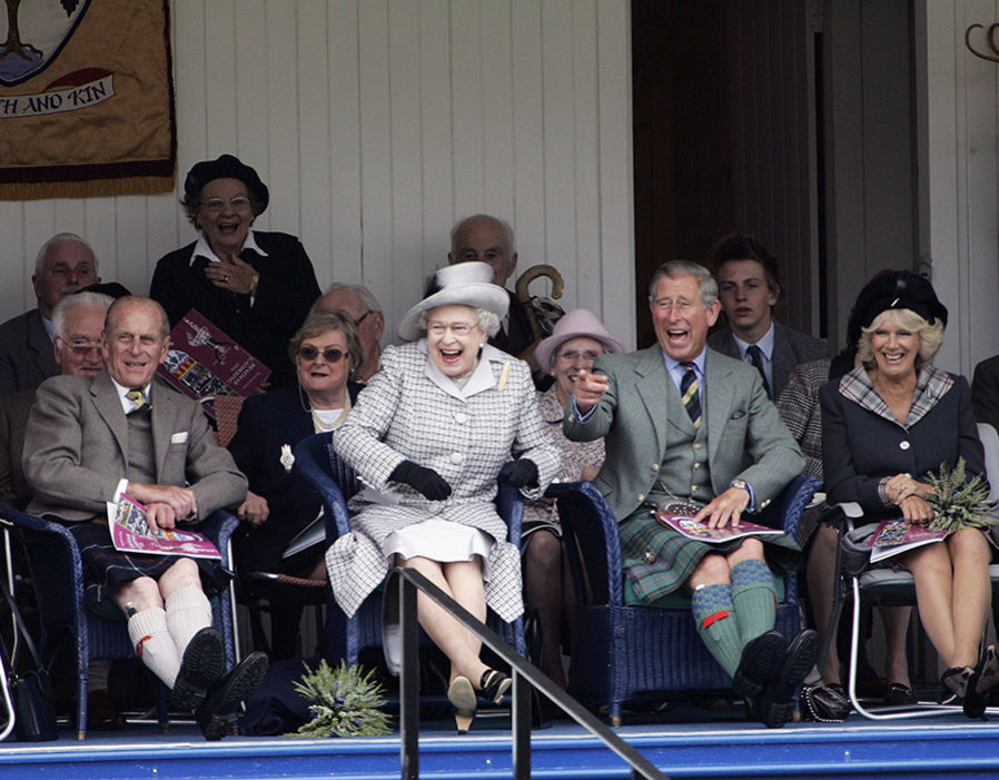 Prince Charles, Prince of Wales and Camilla, Duchess of Cornwall with Queen Elizabeth II and Prince Philip, Duke of Edinburgh laugh at their Balmoral team in the tug of war competition Photo (C) GETTY