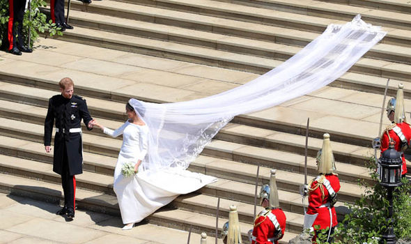 The focus of the dress is the graphic open bateau neckline Photo (C) GETTY