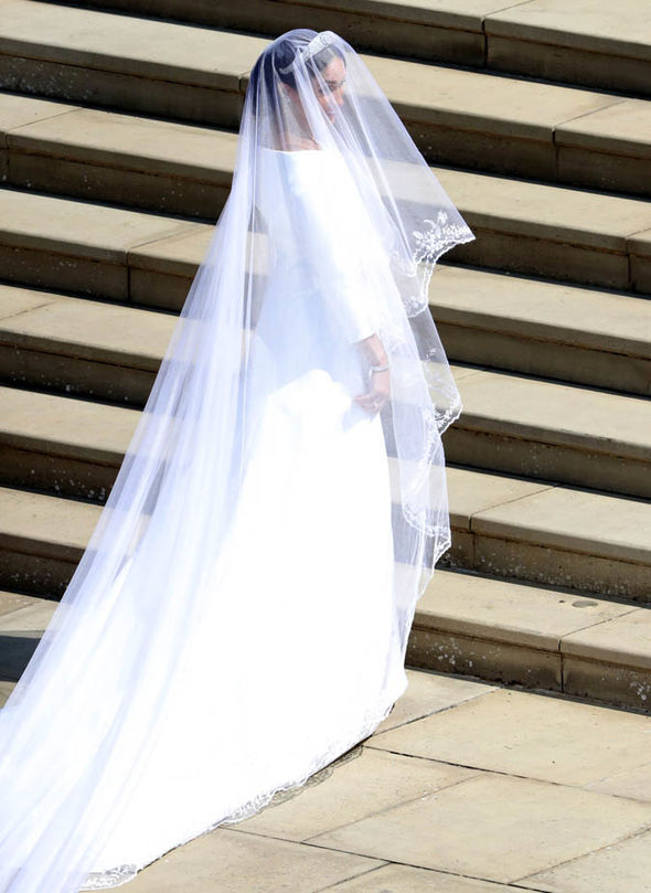 The veil was a much-praised masterpiece, made from silk tulle with trim of hand-embroidered flowers Photo (C) GETTY