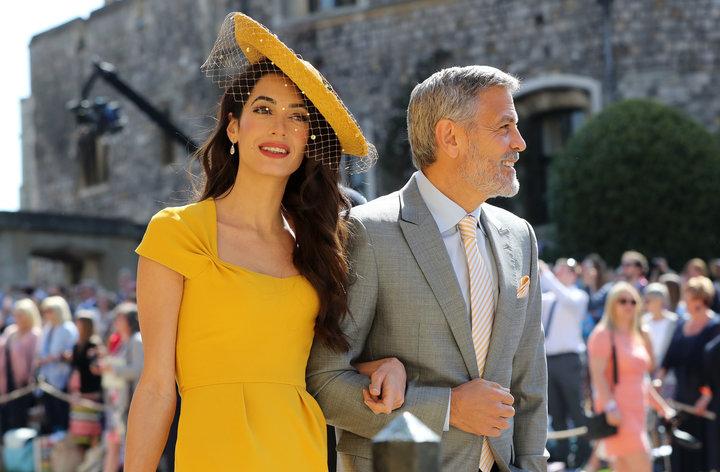 Amal Clooney and George Clooney arrive at St. George Photo (C) GETTY