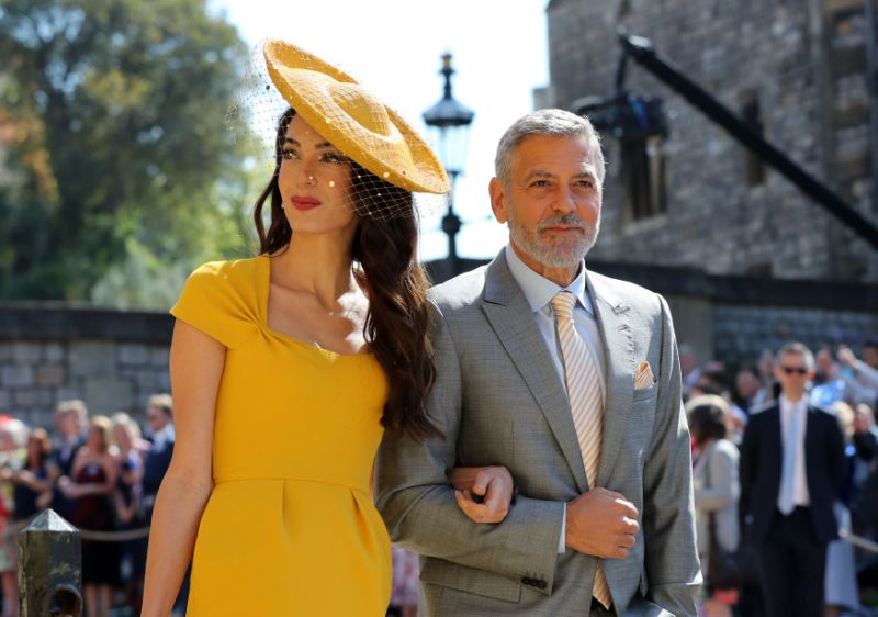 Amal and husband George Clooney were A-list guests at Prince Harry and Meghan Markle's wedding on May 19. Source Getty