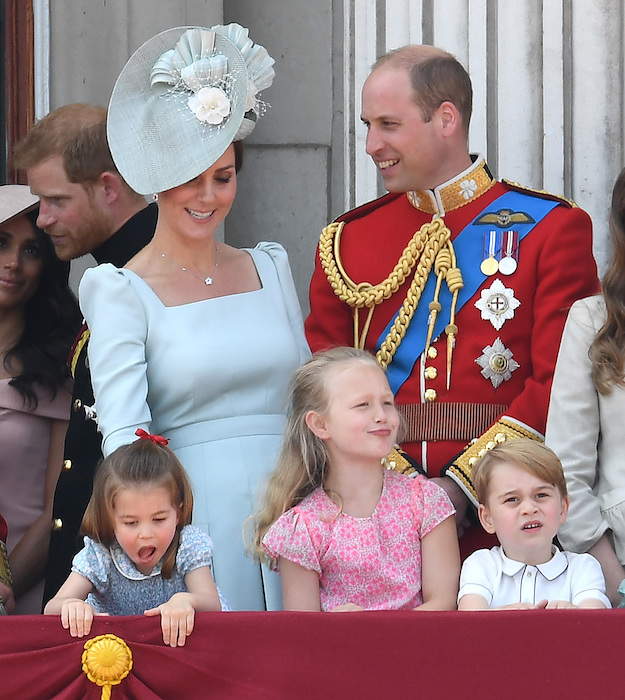 Charlotte also couldnt resist having a cheeky peek over the balcony while George looked on in awe Photo C GETTY