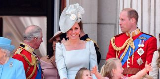 ENGAGED Kate Middleton breaks into a smile as she tends to Princess Charlotte