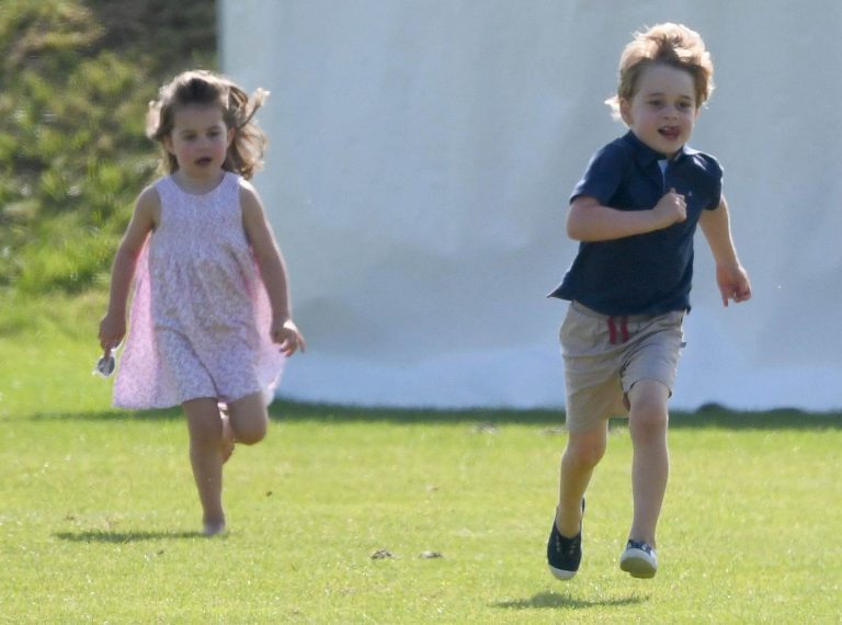 George and Charlotte had a race on the grass which they took very seriously (Picture i-Images)