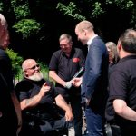 HRH meets injured veterans who are enjoying the @iom tt at the Joey Dunlop foundation with Let's Do a charity that organises trip to motorsport