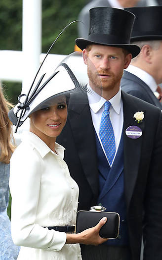 Harry looked dapper at Meghan's side, wearing a suit and top hat. Photo (C) Getty Images