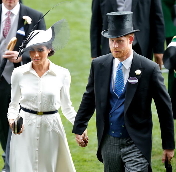 Harry was barely able to let go of Meghan's hand at Ascot on Tuesday Photo (C) GETTY