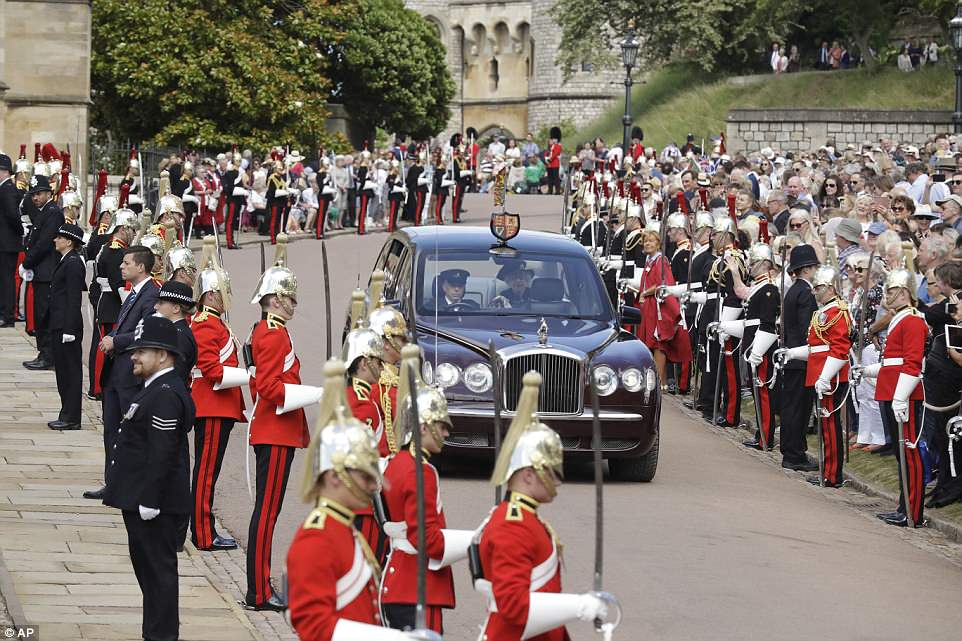 Her Majesty arrived at the chapel by state limousine while the majority of members of the order processed through the grounds of the castle to the event