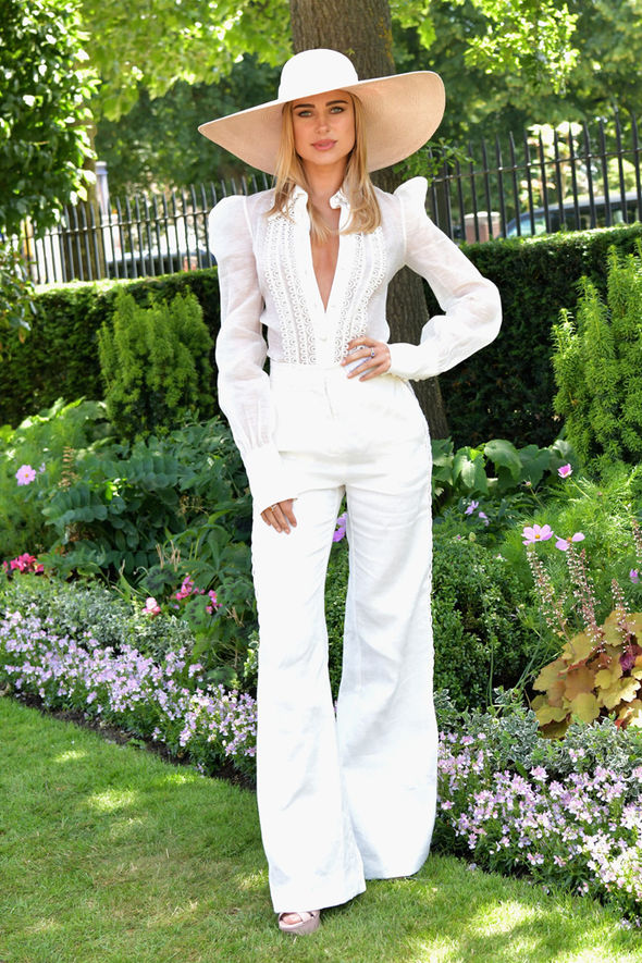 Kimberly Garner looked angelic in a white trouser and shirt ensemble with white oversized hat Photo (C) PA