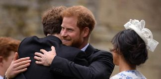 Louis then greeted his cousin Prince Harry with a warm embrace outside the church pictured