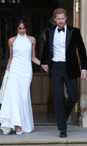 Meghan Markle dresses The Duchess wore a fishtail dress by Stella McCartney for her reception Photo (C) GETTY