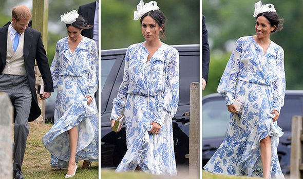 Meghan Markle looked summery in a floaty floral frock Photo (C) GEOFF ROBINSON