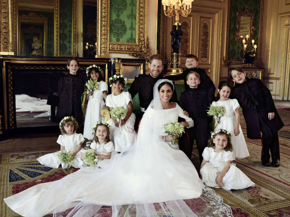 Meghan Markle's bridesmaid Ivy stands with a bouquet Photo (C) KENSINGTOMeghan Markle's bridesmaid Ivy stands with a bouquet Photo (C) KENSINGTON PALACE PALACE