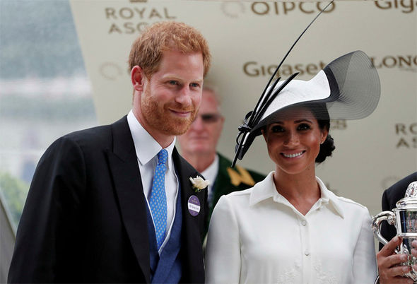 Meghan and Harry presented the winning trophy for the 4.20pm race, the St James' Palace Stakes Photo (C) GETTY
