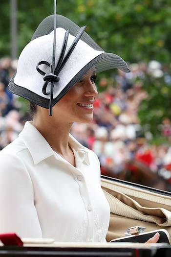 Meghan's hat by Philip Treacy matched her dress perfectly. Photo (C) Getty Images