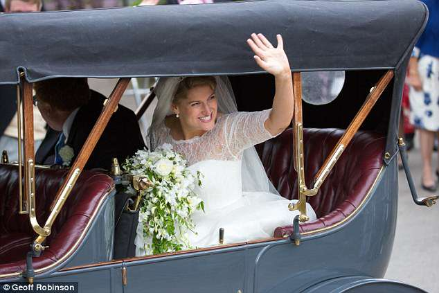 Newlywed Celia beamed as she waved to waiting crowds outside the village church