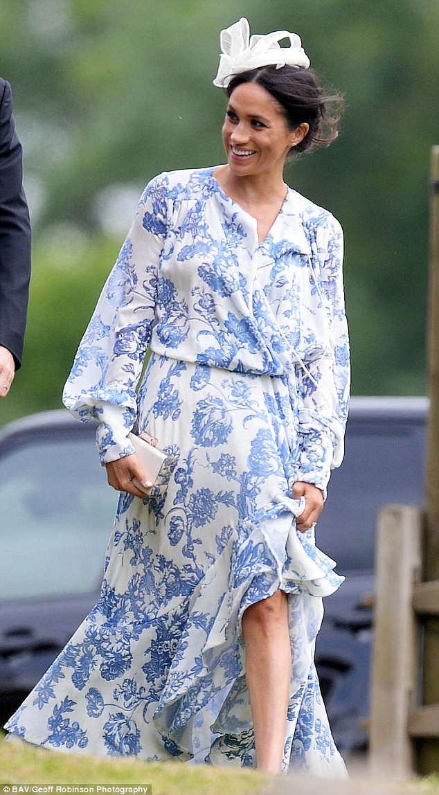 Newlywed Meghan looked stylish in a draped blue and white dress for the oNewlywed Meghan looked stylish in a draped blue and white dress for the occasionccasion