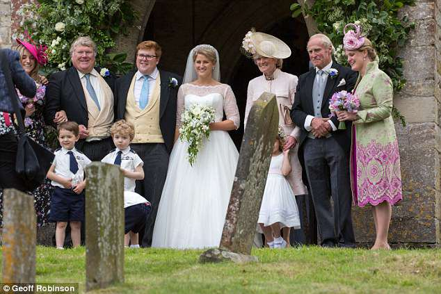 Newlyweds Celia and George, centre, with parents Sarah and Neil McCorquodale, right, sister Emily, far right