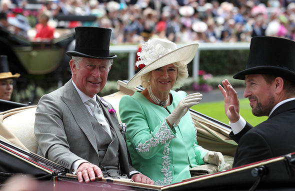 Prince Charles and wife Camilla smiled and waved at fans Photo (C) PA