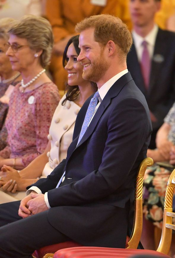 Prince Harry and Meghan smile at the Queen Photo (C) PA