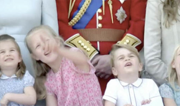 Princess Charlotte and Prince George watch the flypast with their cousins Photo C BBC