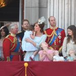 Princess Charlotte seems upset and is comforted by her mother as the four princes watch on