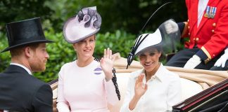 The Countess of Wessex and the Duchess of Sussex wave to crowds from their carriage. Photo (C) The Countess of Wessex and the Duchess of Sussex wave to crowds from their carriage. Photo (C) Getty ImagesGetty Images