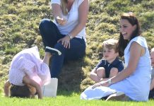 The Duchess of Cambridge laughs as Princess Charlotte does a forward roll at the Maserati Royal Charity Polo Trophy at Beaufort Polo Club, Tetbury, Gloucestershire, UK, on the 10th June 2018. Picture by James Whatling