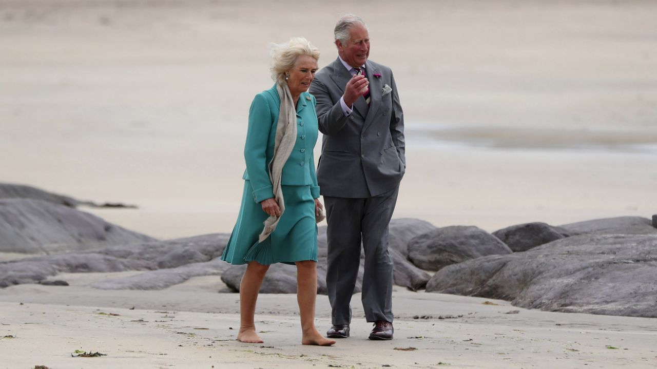 The Duchess of Sussex and Prince Charles take a stroll on a beach in Kerry during a whirlwind trip to Northern Island. Camilla chose to go barefoot, however, kept her nude tights on. Source Getty Images