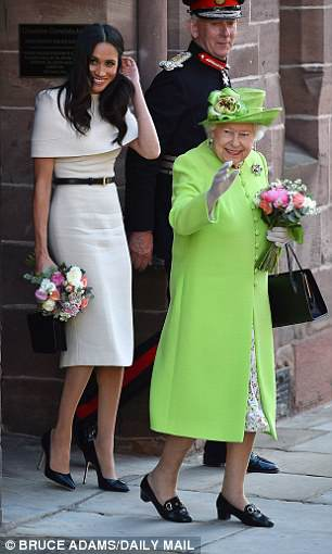 The Queen and Meghan were all smiles as they left Chester Town Hall, with both women carrying pretty bouquets of flowers