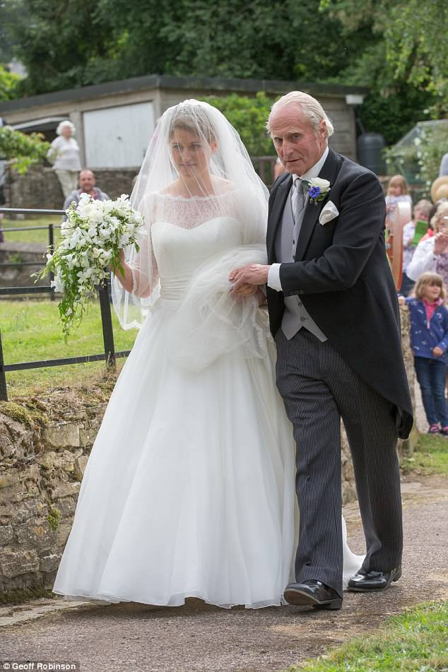 The beautiful bride was escorted to the church by her father Neil McCorquodale