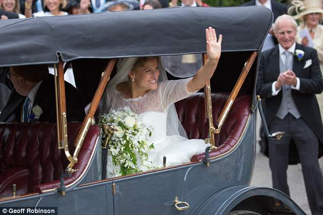 The bride showed off her million-dollar smile as they left the church on Saturday