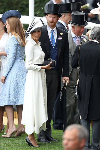 The couple mingled in the royal enclosure with other members of their family, including Prince Charles and Princess Beatrice, both pictured in the background. Photo (C) Getty Images