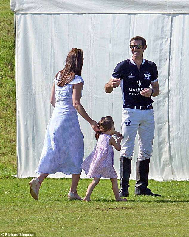 The mother-of-two was accompanied by Princess Charlotte as she dashed to the marquee to congratulate William and his team