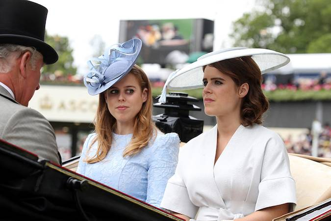 rince Andrew's daughters were dressed to the nines for the races, with Beatrice wearing a pale blue dress and Eugenie also opting for white. Photo (C) Getty Images
