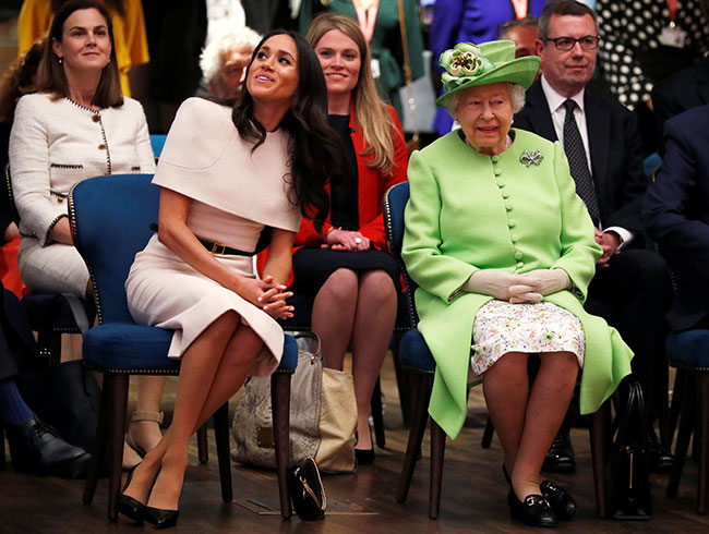 Meghan Markle mirrors the Queen as she perfects royal posture at Buckingham Palace Photo (C) Getty