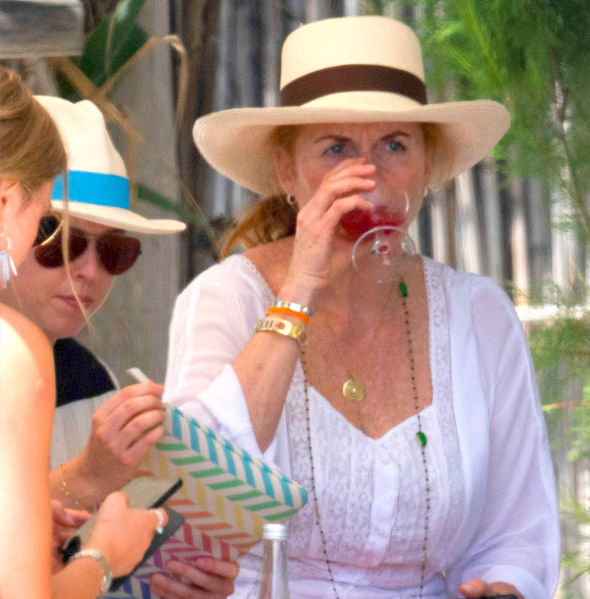 Sarah Ferguson On her head Fergie donned a white hat with a brown band around it Photo (C) GOFF