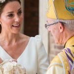 Kate, Duchess of Cambridge speaks to Archbishop of Canterbury Justin Welby as she arrives carrying Prince Louis for his christening service at the Chapel Royal, St James