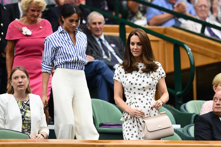 In their first-ever solo outing, Meghan Markle and Kate Middleton are watching the women's singles final at Wimbledon right now Photo (C) GETTY
