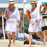2 Sarah Ferguson On her head Fergie donned a white hat with a brown band around it Photo (C) GOFF