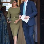 Another shot of Meghan in her head-to-toe olive green outfit. Her matching hat, in her favourite disc style, was by Stephen Jones.. Photo (C) PA