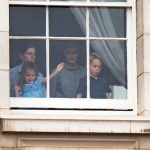 Charlotte and George watched the flypast from the window Photo (C) WENN