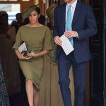Duchess Meghan looked gorgeous in an olive green Ralph Lauren midi dress, with her signature favourite bateau neckline Photo (C) PA
