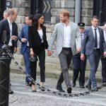 It is believed Meghan wears heels to undermine the height difference between her and Prince Harry Photo (C) PA
