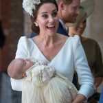 Kate Middleton is seen holding a sleeping Prince Louis at the christening [Getty]
