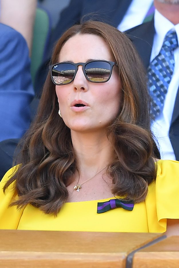 Kate Middleton wore a yellow dress and a meaningful bow brooch to the Wimbledon final [Getty]