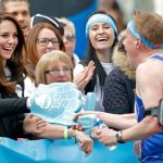 Kate attended the marathon but as a spectator, handing out water and cheering on runners Photo (C) GETTY IMAGES