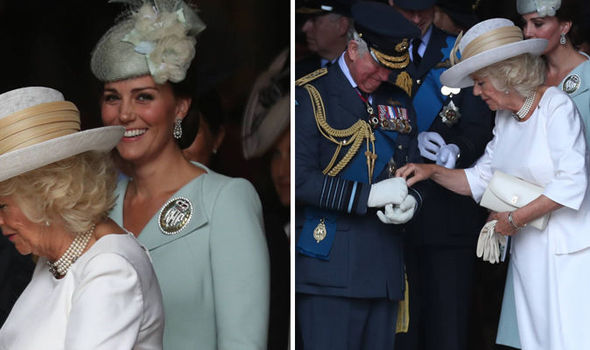 Kate saw the funny side as Charles struggled with his gloves Photo (C) PA